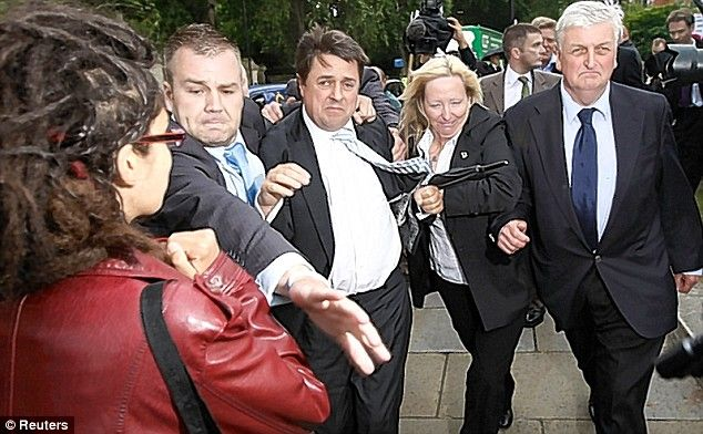Rough: A woman is barged aside for the BNP leader and MEP Andrew Brons