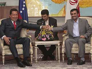 Sept. 5: Venezuela's President Hugo Chavez, left, shakes hands with Iran's President Mahmoud Ahmadinejad during a meeting in Tehran on Saturday.