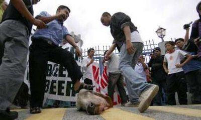 Muslims stomping on head of Hindu Sacred Cow