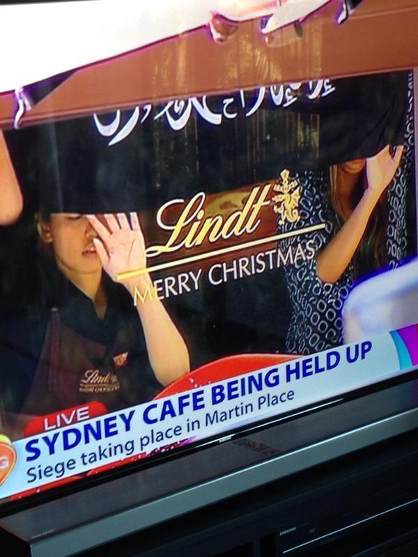 Hostages Oz hold up flag